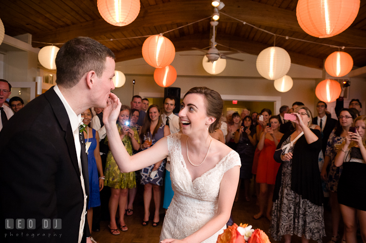 Bride feeding cake to Groom during cake cutting. Historic London Town and Gardens wedding photos at Edgewater Annapolis, Maryland by photographers of Leo Dj Photography. http://leodjphoto.com
