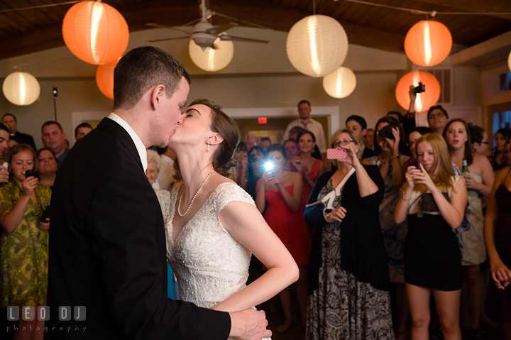 Bride and Groom kissing after the cake cutting. Historic London Town and Gardens wedding photos at Edgewater Annapolis, Maryland by photographers of Leo Dj Photography. http://leodjphoto.com
