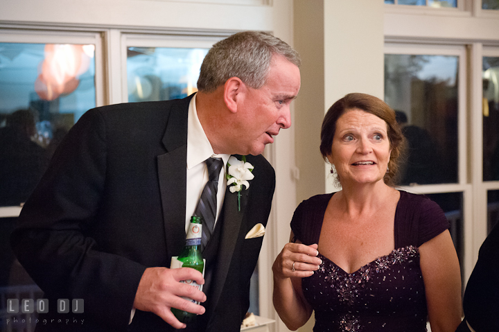 Mother and Father of Groom talking. Historic London Town and Gardens wedding photos at Edgewater Annapolis, Maryland by photographers of Leo Dj Photography. http://leodjphoto.com