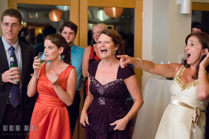Mother of Groom and guests laughing. Historic London Town and Gardens wedding photos at Edgewater Annapolis, Maryland by photographers of Leo Dj Photography. http://leodjphoto.com
