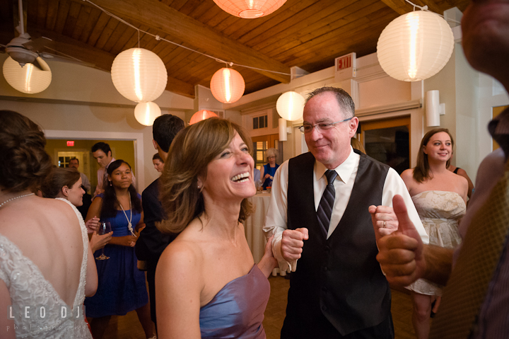 Bride's Mother and Father dancing and laughing. Historic London Town and Gardens wedding photos at Edgewater Annapolis, Maryland by photographers of Leo Dj Photography. http://leodjphoto.com
