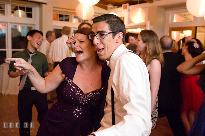 Groom's Mother singing together with another guest. Historic London Town and Gardens wedding photos at Edgewater Annapolis, Maryland by photographers of Leo Dj Photography. http://leodjphoto.com