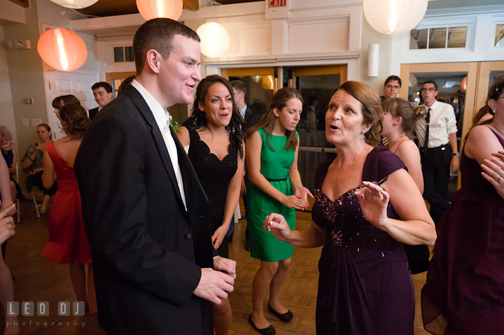 Mother and Groom singing together. Historic London Town and Gardens wedding photos at Edgewater Annapolis, Maryland by photographers of Leo Dj Photography. http://leodjphoto.com