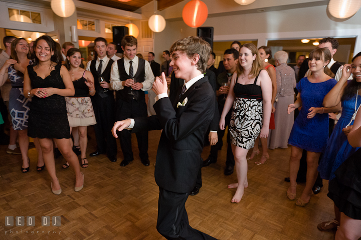 Brother of Bride dancing and laughing. Historic London Town and Gardens wedding photos at Edgewater Annapolis, Maryland by photographers of Leo Dj Photography. http://leodjphoto.com