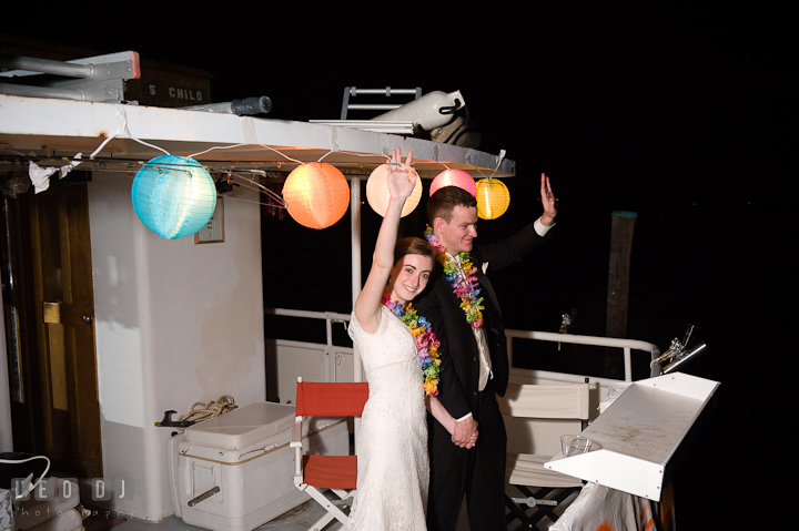 Bride and Groom waving from the boat. Historic London Town and Gardens wedding photos at Edgewater Annapolis, Maryland by photographers of Leo Dj Photography. http://leodjphoto.com