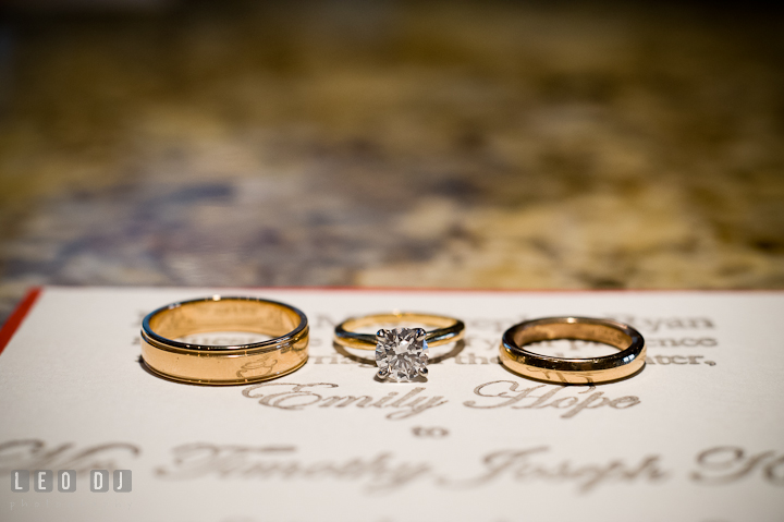 Wedding band, wedding ring, and diamond engagement ring close up shot. Saint John the Evangelist church wedding ceremony photos at Severna Park, Maryland by photographers of Leo Dj Photography. http://leodjphoto.com