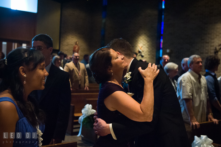 Groom hugging his Mother. Saint John the Evangelist church wedding ceremony photos at Severna Park, Maryland by photographers of Leo Dj Photography. http://leodjphoto.com