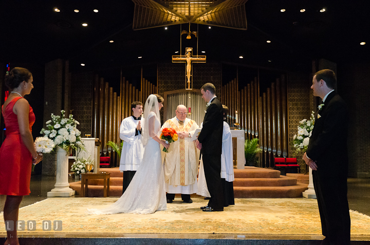 Bride, Groom, Matron of Honor and Best Man in the sanctuary. Saint John the Evangelist church wedding ceremony photos at Severna Park, Maryland by photographers of Leo Dj Photography. http://leodjphoto.com