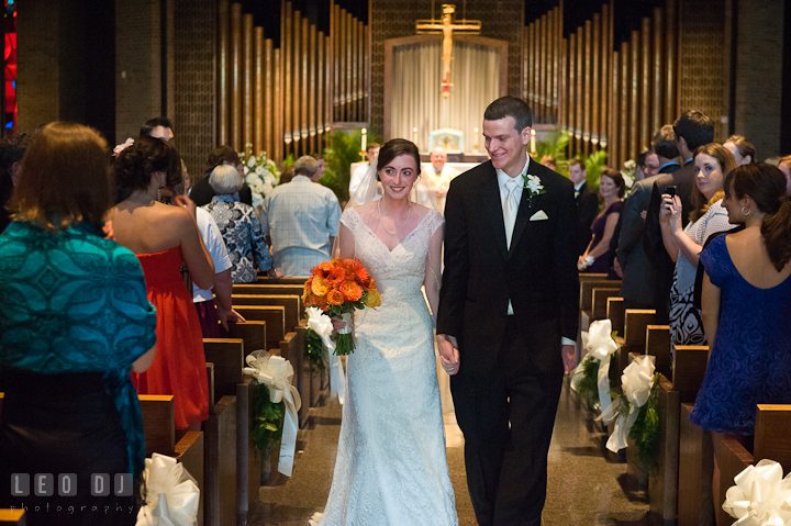 Bride and Groom walking out during the recessional. Saint John the Evangelist church wedding ceremony photos at Severna Park, Maryland by photographers of Leo Dj Photography. http://leodjphoto.com
