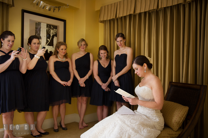 Bride reading letter and card from Groom as Maid of Honor and Bridesmaids watched. The Tidewater Inn wedding, Easton, Eastern Shore, Maryland, by wedding photographers of Leo Dj Photography. http://leodjphoto.com