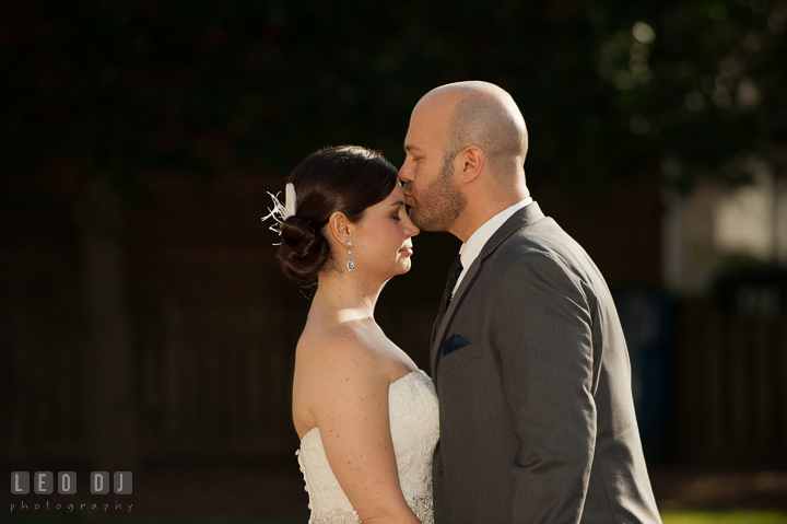 Groom kissed Bride on her forehead during first look. The Tidewater Inn wedding, Easton, Eastern Shore, Maryland, by wedding photographers of Leo Dj Photography. http://leodjphoto.com