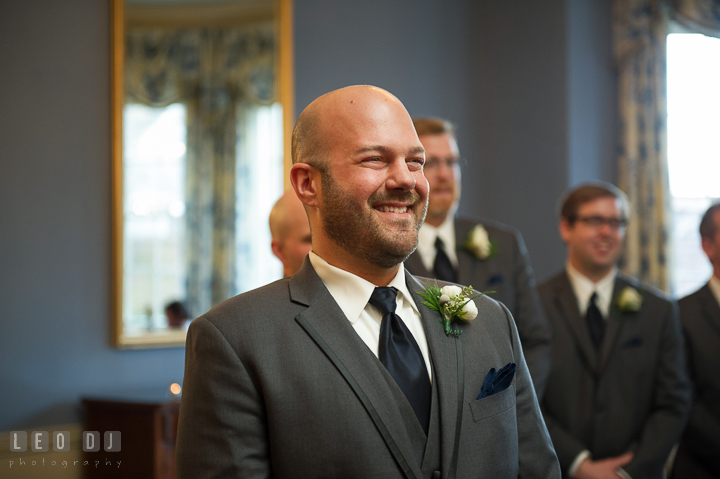 Groom smiling seeing Bride walking down the aisle during procession. The Tidewater Inn wedding, Easton, Eastern Shore, Maryland, by wedding photographers of Leo Dj Photography. http://leodjphoto.com