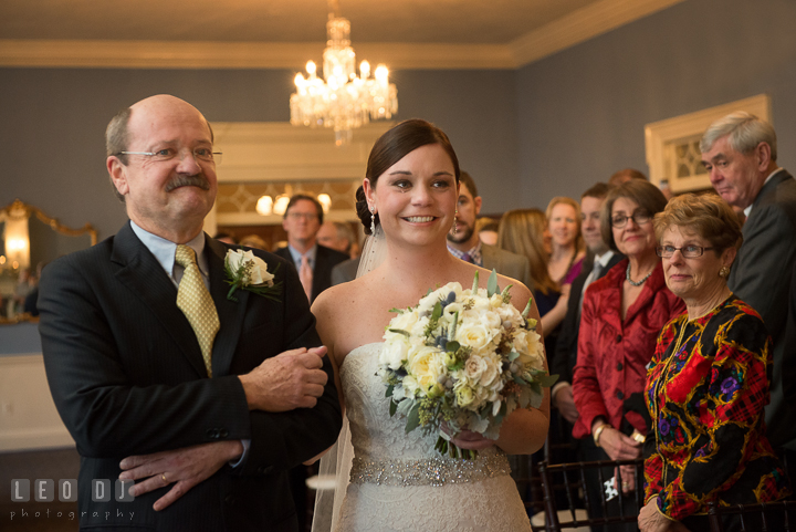 Bride sheds tear as walking down the aisle escorted by Father during processional. The Tidewater Inn wedding, Easton, Eastern Shore, Maryland, by wedding photographers of Leo Dj Photography. http://leodjphoto.com