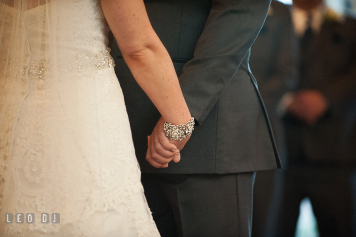 Bride and Groom holding hands during ceremony. The Tidewater Inn wedding, Easton, Eastern Shore, Maryland, by wedding photographers of Leo Dj Photography. http://leodjphoto.com