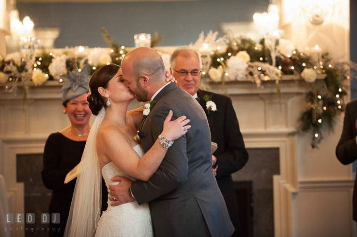 Bride and Groom kissed after pronounced as Husband and Wife by officiants. The Tidewater Inn wedding, Easton, Eastern Shore, Maryland, by wedding photographers of Leo Dj Photography. http://leodjphoto.com