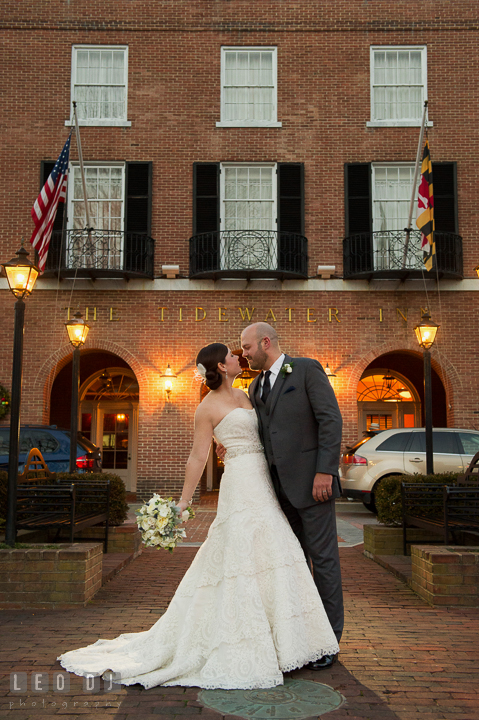 Bride holding bouquet by Monteray Farms almost kissed Groom in front of venue entrance. The Tidewater Inn wedding, Easton, Eastern Shore, Maryland, by wedding photographers of Leo Dj Photography. http://leodjphoto.com