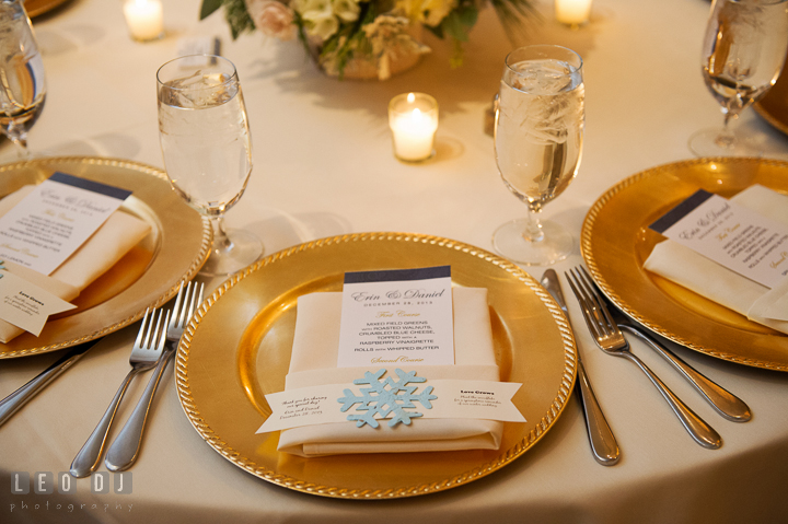 Table setting with golden plates, menu, with winter themed decoration. The Tidewater Inn wedding, Easton, Eastern Shore, Maryland, by wedding photographers of Leo Dj Photography. http://leodjphoto.com