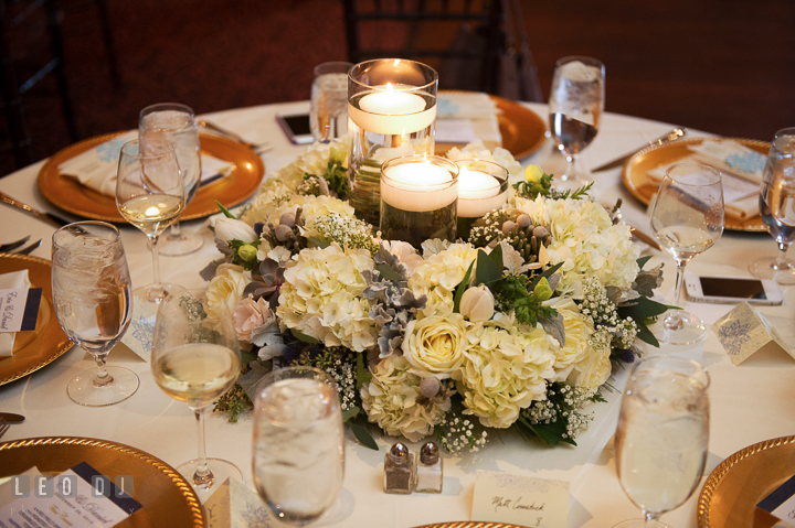 Candle table centerpiece with white roses and hydrangeas by florist Monteray Farms. The Tidewater Inn wedding, Easton, Eastern Shore, Maryland, by wedding photographers of Leo Dj Photography. http://leodjphoto.com