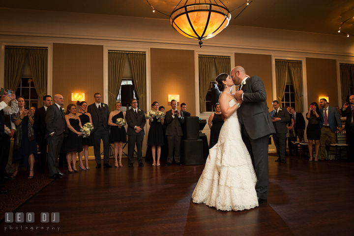 Groom and Bride kissing during first dance and observed by the wedding bridal party. The Tidewater Inn wedding, Easton, Eastern Shore, Maryland, by wedding photographers of Leo Dj Photography. http://leodjphoto.com