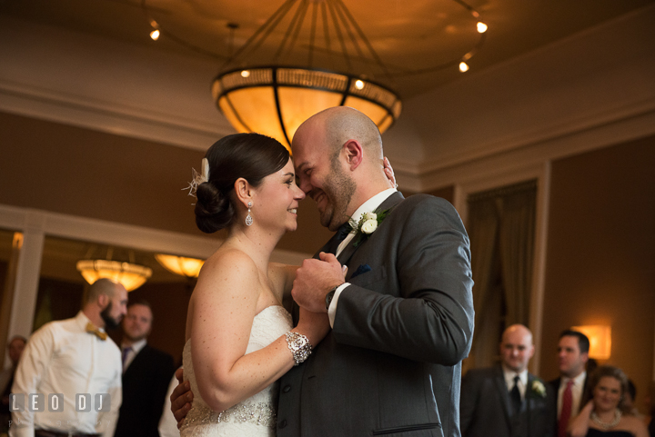 Bride and Groom smiling during first dance. The Tidewater Inn wedding, Easton, Eastern Shore, Maryland, by wedding photographers of Leo Dj Photography. http://leodjphoto.com