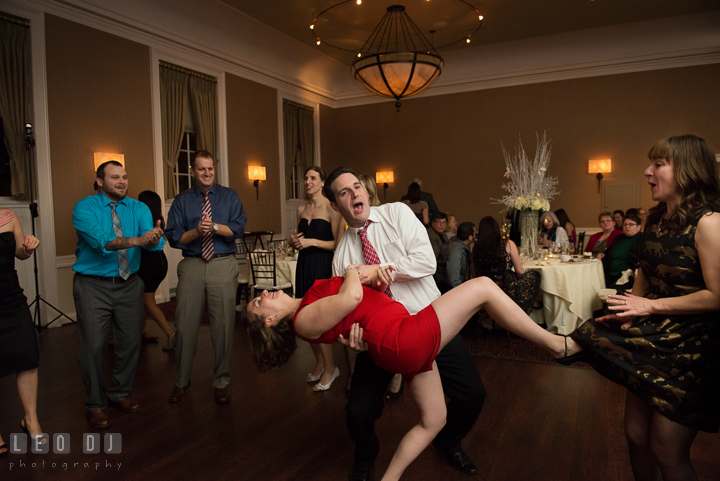 A couple doing the dip accidentally almost opened another guest's skirt. The Tidewater Inn wedding, Easton, Eastern Shore, Maryland, by wedding photographers of Leo Dj Photography. http://leodjphoto.com