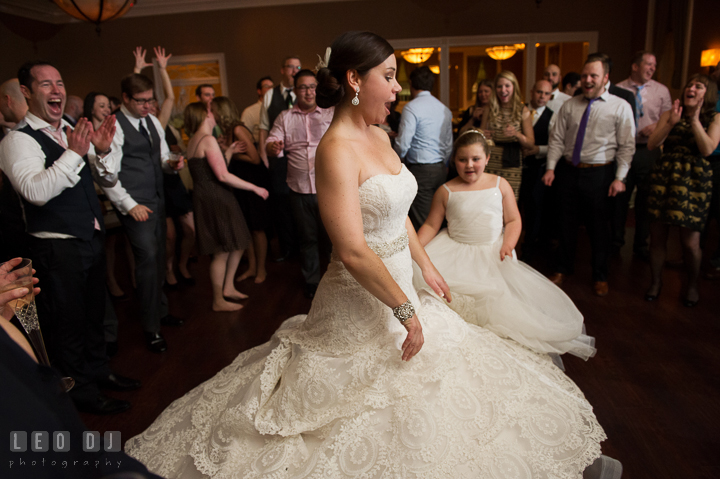 Bride and flower girl twirling their dresses together. The Tidewater Inn wedding, Easton, Eastern Shore, Maryland, by wedding photographers of Leo Dj Photography. http://leodjphoto.com