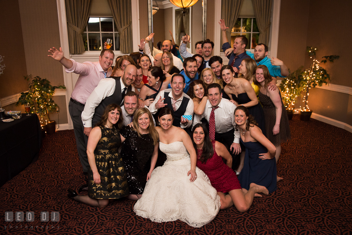 A photo group shot of Bride and Groom and their college and high school friends. The Tidewater Inn wedding, Easton, Eastern Shore, Maryland, by wedding photographers of Leo Dj Photography. http://leodjphoto.com