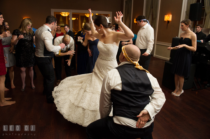 Bride twirling her dress while dancing with Groomsman. The Tidewater Inn wedding, Easton, Eastern Shore, Maryland, by wedding photographers of Leo Dj Photography. http://leodjphoto.com