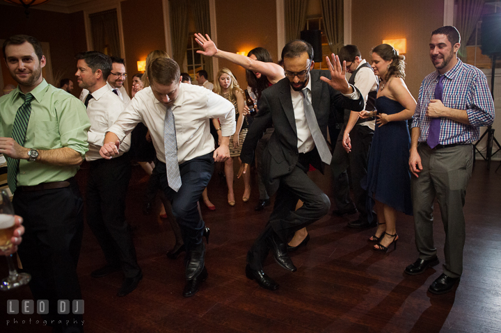 Two guests showing their cool moves dancing to music by DJ from Absolute Entertainment. The Tidewater Inn wedding, Easton, Eastern Shore, Maryland, by wedding photographers of Leo Dj Photography. http://leodjphoto.com