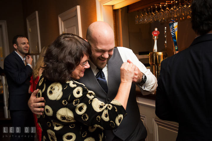 Impromptu dance of Groom with his Mother in front of the bar. The Tidewater Inn wedding, Easton, Eastern Shore, Maryland, by wedding photographers of Leo Dj Photography. http://leodjphoto.com
