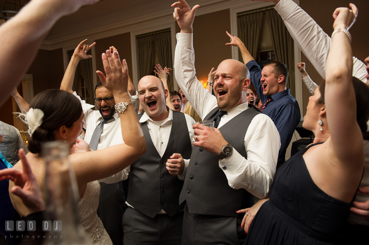 Bride and Groom singing along their favorite song played by DJ from Absolute Entertainment. The Tidewater Inn wedding, Easton, Eastern Shore, Maryland, by wedding photographers of Leo Dj Photography. http://leodjphoto.com