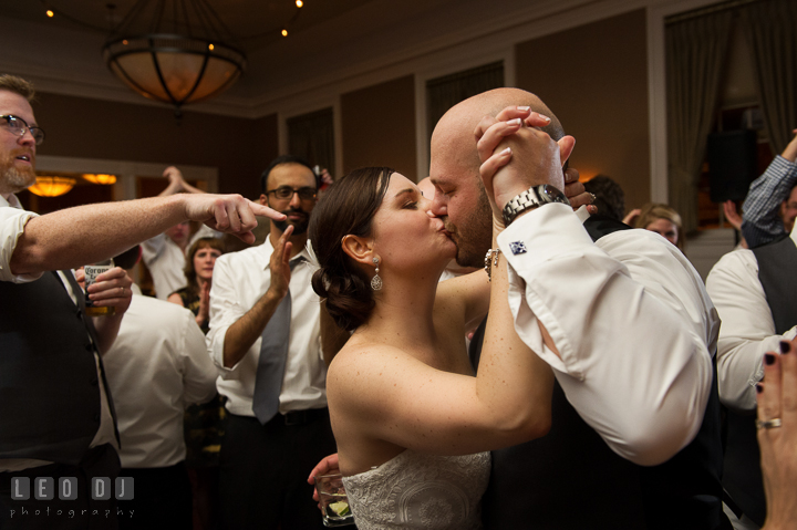 Bride and Groom kissing at the end of the reception party dance. The Tidewater Inn wedding, Easton, Eastern Shore, Maryland, by wedding photographers of Leo Dj Photography. http://leodjphoto.com