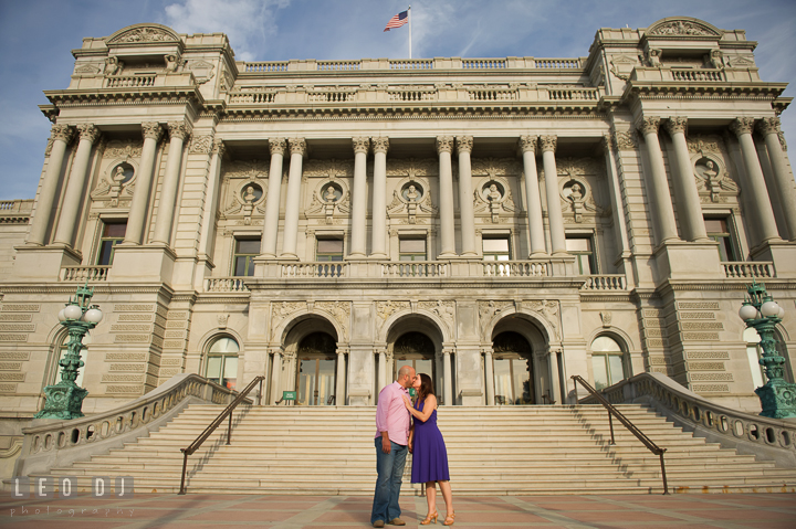 Engaged couple kissing in front of a beautiful antique building by the Capitol Hill. Washington DC pre-wedding engagement photo session, by wedding photographers of Leo Dj Photography. http://leodjphoto.com