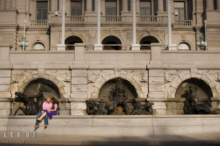 Engaged couple cuddling by the water fountains by the Capitol Hill. Washington DC pre-wedding engagement photo session, by wedding photographers of Leo Dj Photography. http://leodjphoto.com