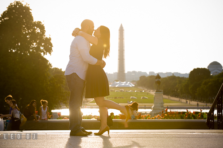 Engaged couple almost kissing with the Washington Monument in the background. Washington DC pre-wedding engagement photo session, by wedding photographers of Leo Dj Photography. http://leodjphoto.com