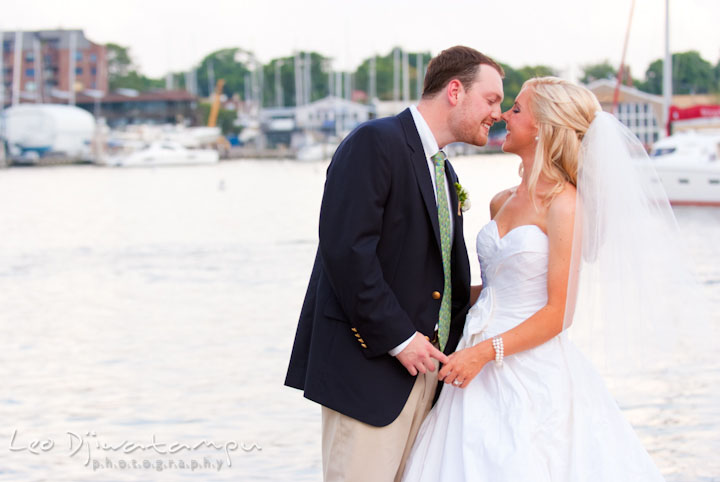 Bride and groom almost kissed by the downtown Annapolis harbor. Historic Inn Governor Calvert House Annapolis Maryland wedding photos by photographers of Leo Dj Photography.