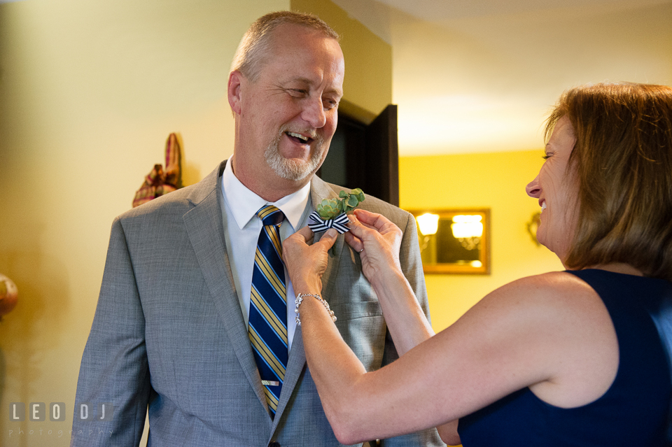 Mother of Bride helping Father of Bride putting on boutonniere. USNA, US Naval Academy military wedding at Annapolis Maryland, by wedding photographers of Leo Dj Photography. http://leodjphoto.com