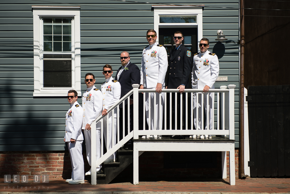 Naval officer Groom posing with Best Man in firemen uniform and groomsmen in Navy uniform. USNA, US Naval Academy military wedding at Annapolis Maryland, by wedding photographers of Leo Dj Photography. http://leodjphoto.com