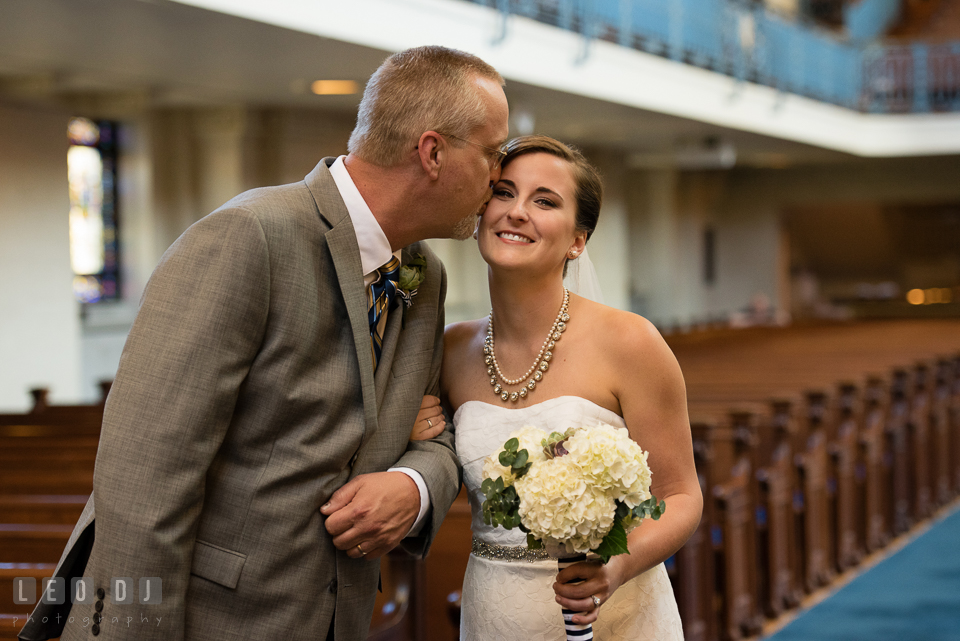 Father of the Bride kissed his daughter while walking down the aisle during the ceremony. USNA, US Naval Academy military wedding at Annapolis Maryland, by wedding photographers of Leo Dj Photography. http://leodjphoto.com