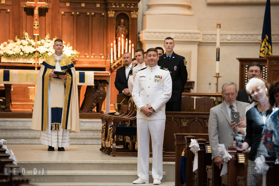 Groom's surprise reaction at the first glimpse of his Bride, the moment she walked down the aisle escorted by her father. USNA, US Naval Academy military wedding at Annapolis Maryland, by wedding photographers of Leo Dj Photography. http://leodjphoto.com
