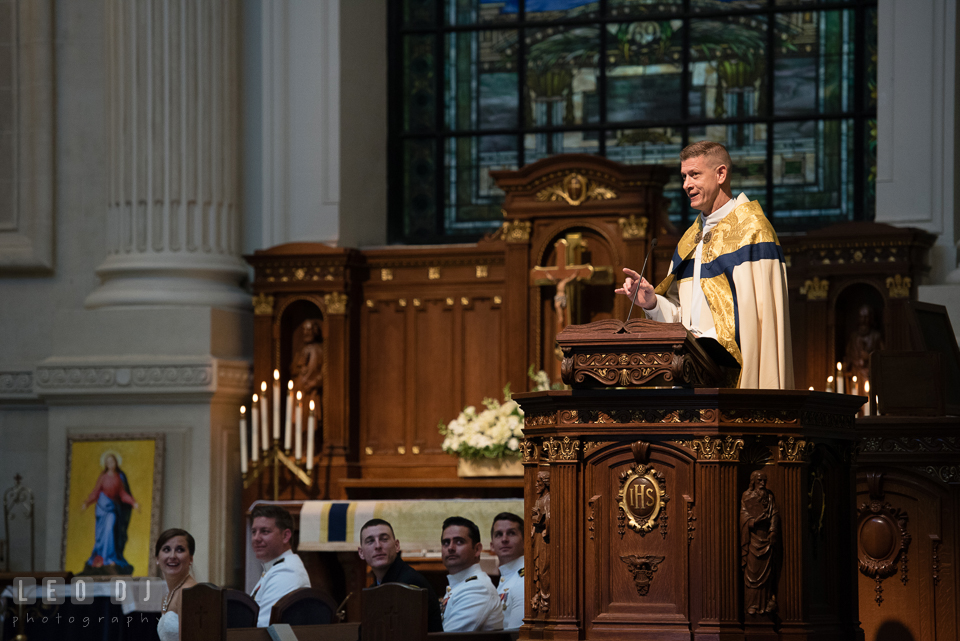 The priest, Father Robert O'Flanagan, giving his speech to the Bride and Groom during the ceremony. USNA, US Naval Academy military wedding at Annapolis Maryland, by wedding photographers of Leo Dj Photography. http://leodjphoto.com