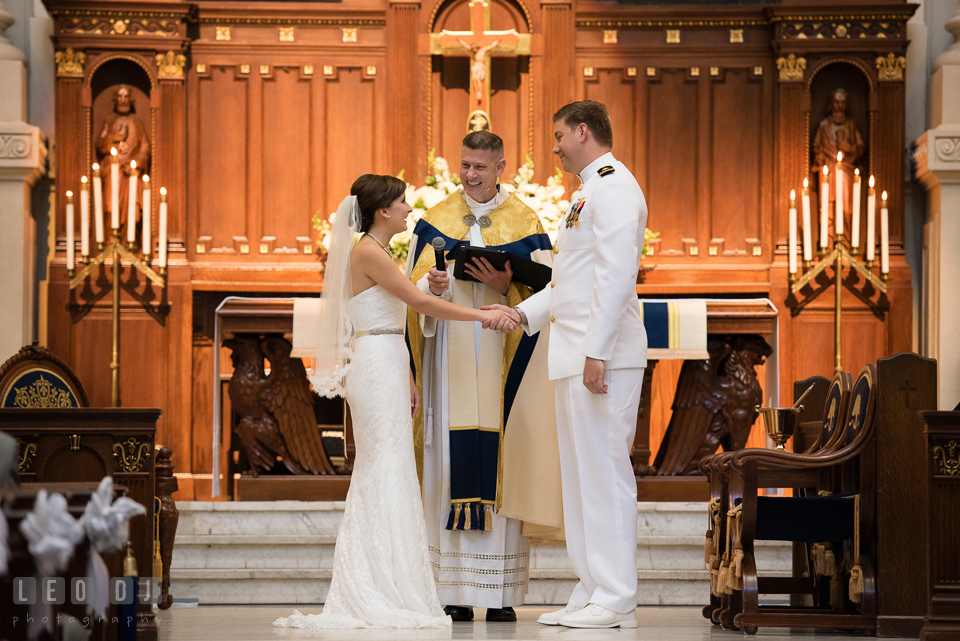 Bride and Groom reciting their vows during the wedding ceremony. USNA, US Naval Academy military wedding at Annapolis Maryland, by wedding photographers of Leo Dj Photography. http://leodjphoto.com