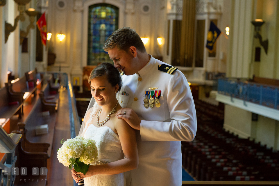 Groom embracing Bride after the ceremony in the USNA Chapel. USNA, US Naval Academy military wedding at Annapolis Maryland, by wedding photographers of Leo Dj Photography. http://leodjphoto.com