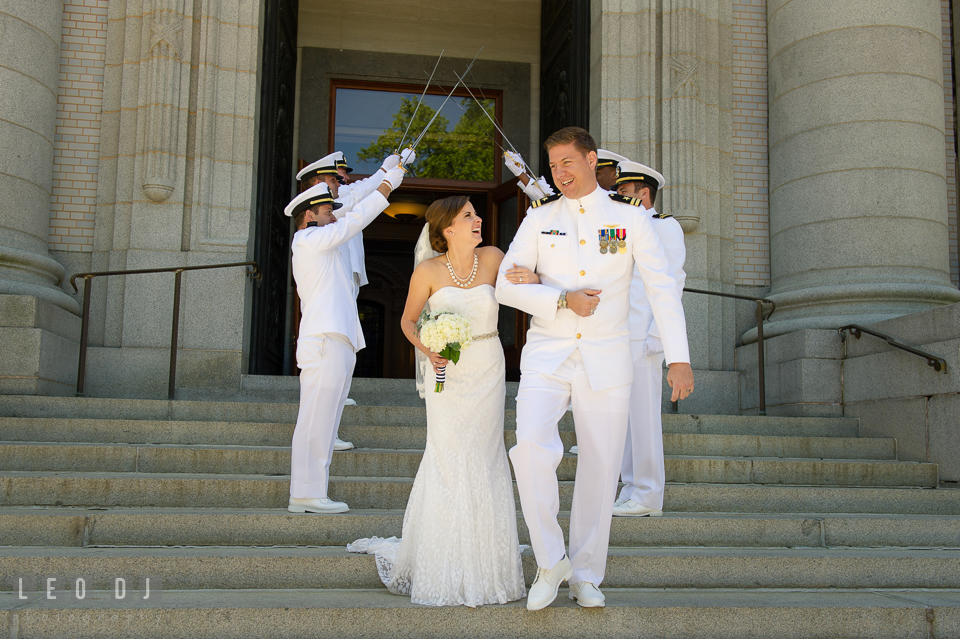 Bride and Groom laughing as they exit the Chapel through the swords arch, welcoming the Bride to the Navy. USNA, US Naval Academy military wedding at Annapolis Maryland, by wedding photographers of Leo Dj Photography. http://leodjphoto.com
