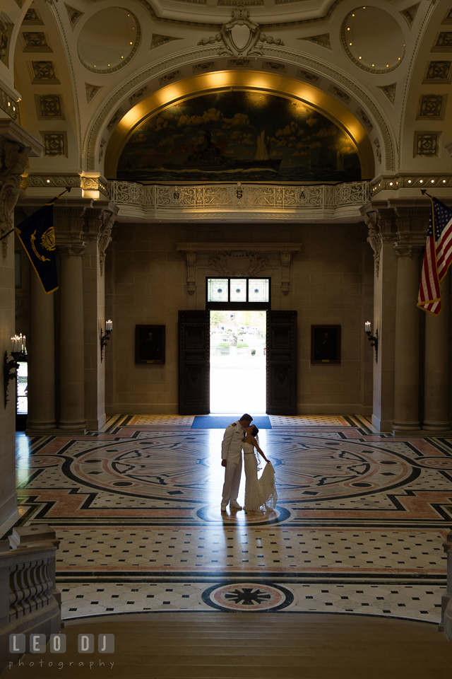 Silhouette of Bride and Groom kissing in the lobby of Bancroft Hall. USNA, US Naval Academy military wedding at Annapolis Maryland, by wedding photographers of Leo Dj Photography. http://leodjphoto.com