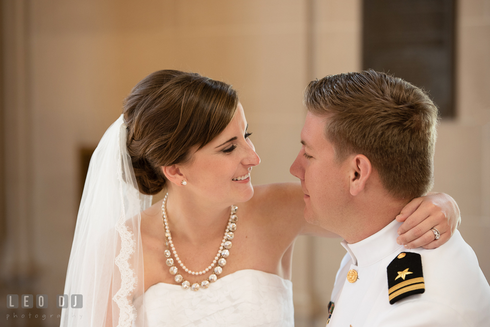Bride and Groom embracing and smiling together. USNA, US Naval Academy military wedding at Annapolis Maryland, by wedding photographers of Leo Dj Photography. http://leodjphoto.com