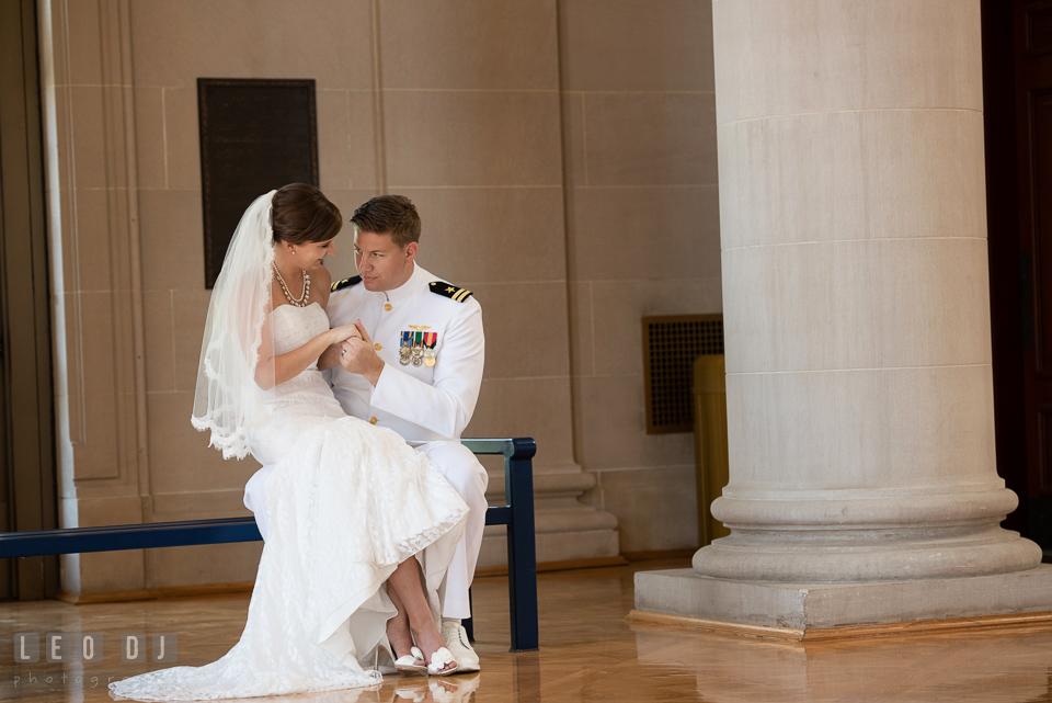 Bride sitting on Groom's lap cuddling. USNA, US Naval Academy military wedding at Annapolis Maryland, by wedding photographers of Leo Dj Photography. http://leodjphoto.com
