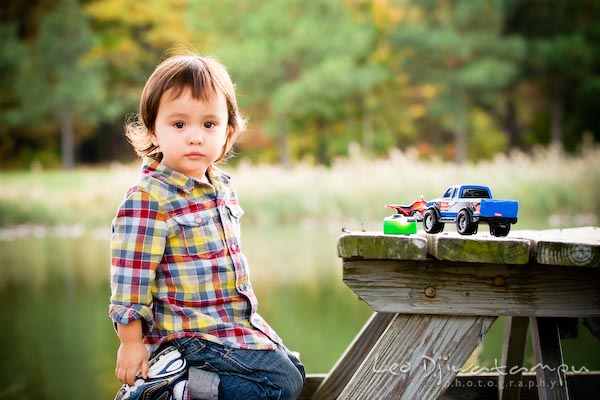 cute boy kid in flanel shirt on picnic table bench with toy truck. Commercial comp card photograper Kent Island Annapolis MD Washington DC