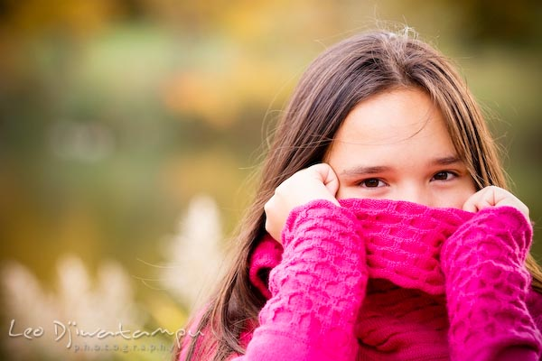 Girl cover face, mouth, nose, with pink sweater. Commercial comp card photograper Kent Island Annapolis MD Washington DC
