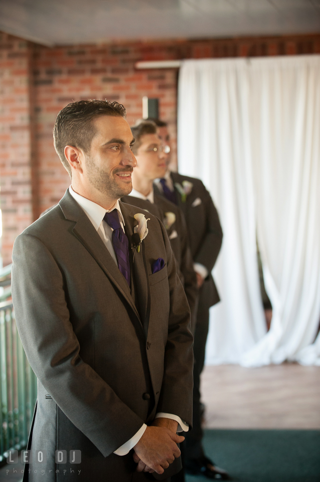 Groom's expression seeing Bride for the first time. Harbour View Events Woodbridge Virginia wedding ceremony and reception photo, by wedding photographers of Leo Dj Photography. http://leodjphoto.com